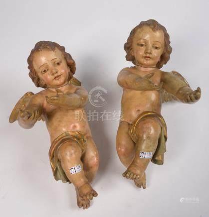 """Paire d'""""Angelots"""" en bois sculpté , polychromé et doré. Epoque: XIXème (?). (* et **). H.:+"""