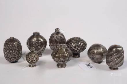 """Ensemble comprenant huit """"Pommeaux de rapières"""" en fer et un en argent au décor géométrique,"""