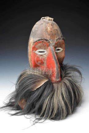 DANCING MASK wood carved, covered with leather & fur, Papua Niugini, 18th century, H: 36 cm / W: