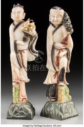 A PAIR OF CHINESE POLYCHROMED SOAPSTONE CARVINGS OF TWO IMMO