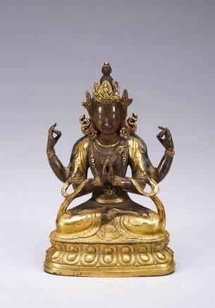 A gilt-bronze figure of four-armed bodhisattva