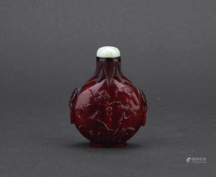 A ruby red glass 'eagle and bear' snuff bottle