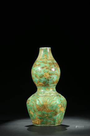 A Chinese green and yellow glazed double gourd vase