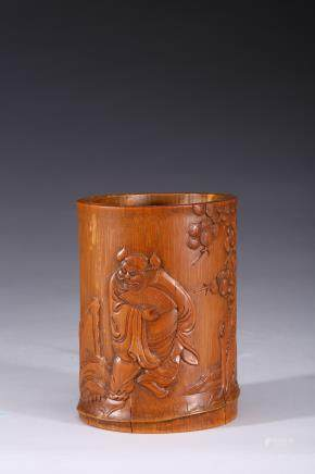 A bamboo carved 'zhongkui' brushpot