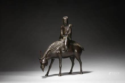 A bronze 'immortal on ram' incense burner