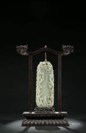 A Chinese celadon jade 'chilong' hanging pendant with stand