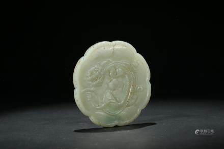A white jade carving of lobed 'chilong' mirror