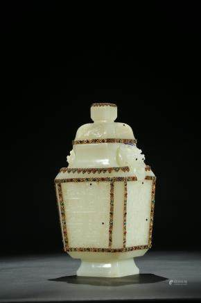A white jade gilt and gems inlaid vase