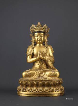 A large gilt bronze figure of Vairocana