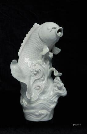 Chinese white porcelain fish on waves