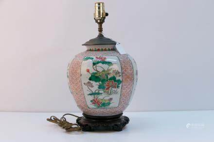 A chinese famille rose lamp with rosewood base