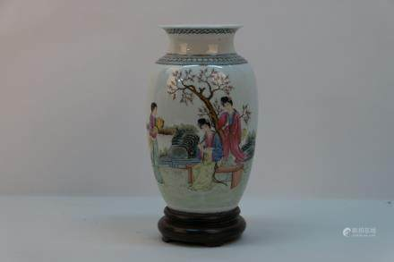 A chinese porcelain bottle with wood base