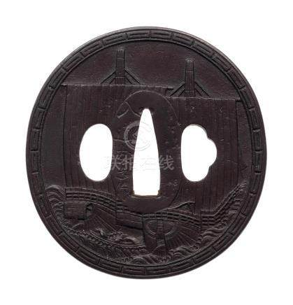 An iron tsuba By Yaji Tomoyuki, Choshu School, early 19th century