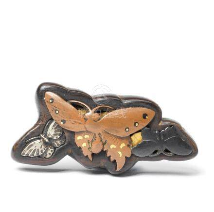 A wood and metal netsuke of three butterflies  19th century