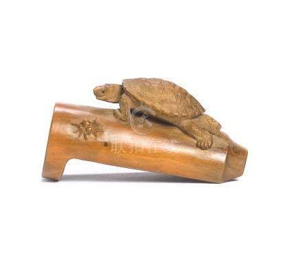 A wood netsuke of a tortoise and spider By Tadakazu, 19th century