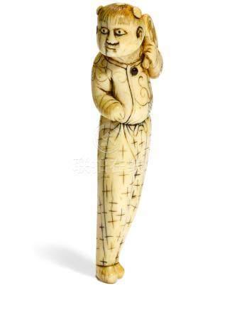 An ivory netsuke of a Chinese boy 18th century