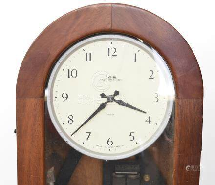 An early 20th Century Smiths electric regulator clock, white face with Arabic numerals, in a