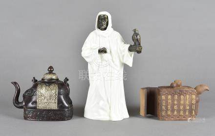 A Minton figure of The Sheikh, in pottery and bronzed metal and two Asian teapots