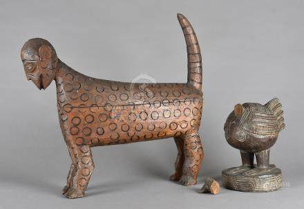 Two carved African mythical beasts, the wooden carved figures modelled as a flightless bird and