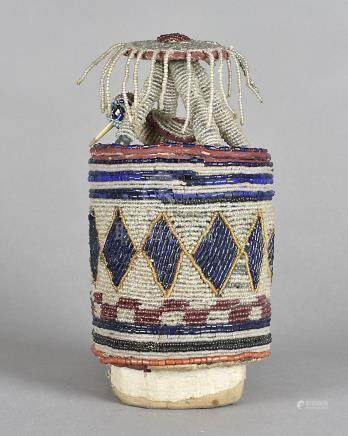 A West African beadwork cylindrical box, the body with all over bands decorated with face and
