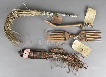 A Nigerian beadwork fly swish, an African knife, hair comb and spoon