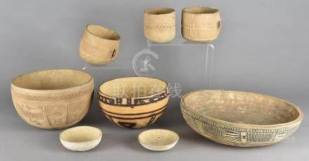 A pair of carved bowls, drinking cups and other African carved bowls