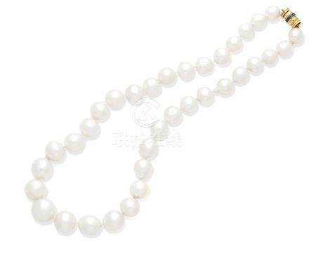 A cultured pearl necklace with a sapphire clasp