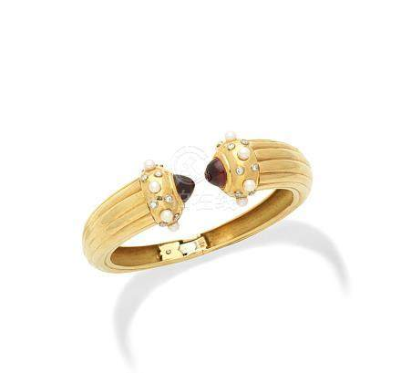 A gem-set bangle, by Annabel Jones