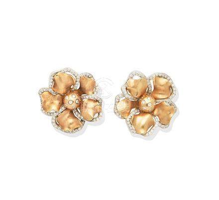 A pair of diamond flower earrings