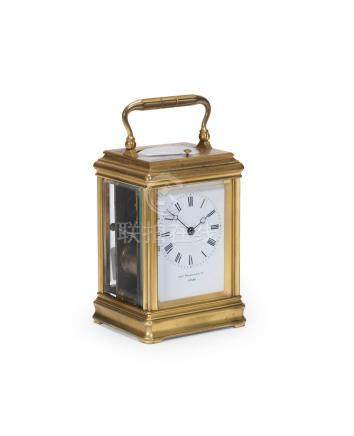 A fine late 19th century French gilt brass carriage clock with Royal provenance to George V (1865-1936) The clock supplied by Drocourt, retailed by Charles Frodsham 19144