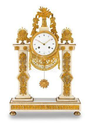 A good early 19th century French ormolu-mounted marble mantel clock
