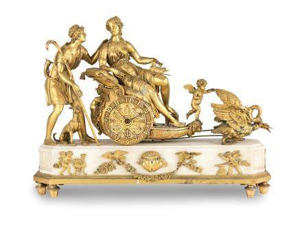 An early 19th century French ormolu-mounted white marble mantel timepiece  The base with an applied pair of ormolu love-struck hearts engraved with the initials VS and AD