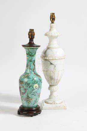 A Chinese porcelain famille verte table lamp, decorated with a scaly dragon, chasing a pearl