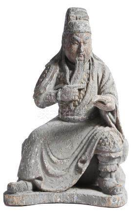 A Chinese carved wood and polychrome decorated figure of Guandi, seated reading a book, Qing