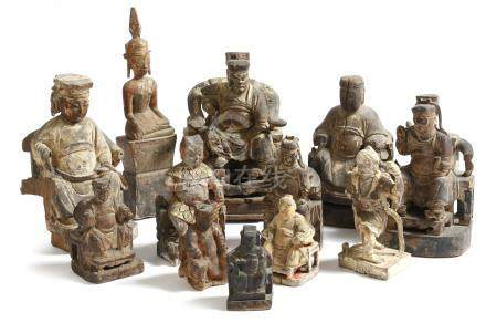Nine Chinese carved wood throne figures, each seated, with traces of polychrome decoration, together