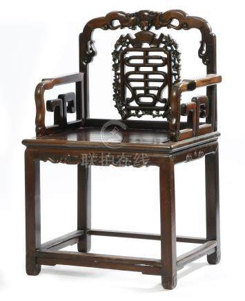 A Chinese hardwood open armchair, with a carved and pierced splat back, decorated with birds and