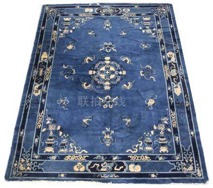 A Chinese carpet, with a blue ground and decorated with auspicious objects, including: bats,