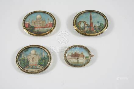 AN INDIAN MINIATURE BROOCH depicting the Golden Temple at Amritsar, in gilt metal frame, 3.6cm.