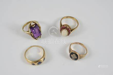 AN 18CT. GOLD AND SAPPHIRE GYPSY RING set with three graduated circular-sapphires, size P 1/2, an