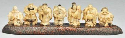 Fine 7 Carved Netsukes Immortal with Wood Base