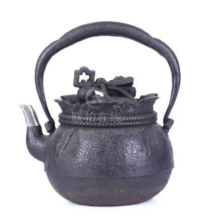 A JAPANESE CAST IRON TEA POT