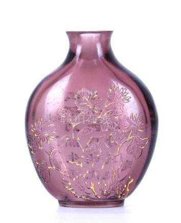 A CHINESE AMETHYST SNUFF BOTTLE