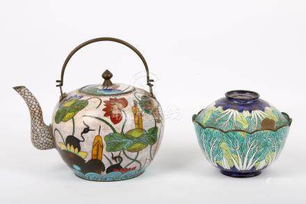 A Chinese cloisonné teapot and cover, 19th Century, enamelled with scrolling leaves and lotus