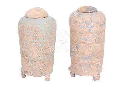A near pair of Chinese tripod jars and covers, Han Dynasty, each of cylindrical section, the body