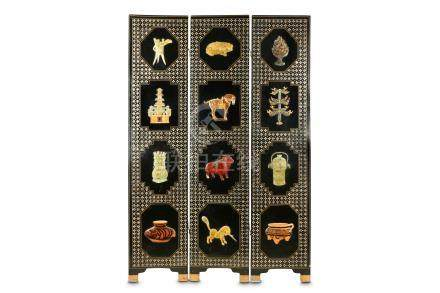 A Chinese style Japanned, parcel gilt, mother of pearl inlaid and hardstone mounted three-panel