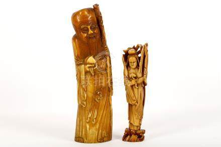 Two Chinese carved ivory figures, Qing Dynasty, 18th / 19th Century, the larger a figure of Shou