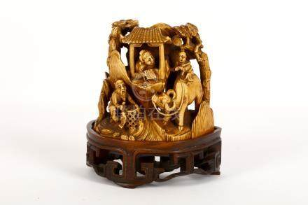 A Chinese carved ivory mountain group, Qing Dynasty, 19th Century, carved to depict a scholar,