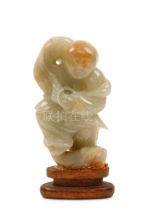 A Chinese jade carving of Liu Hai, Qing dynasty, standing with a three-legged toad below his