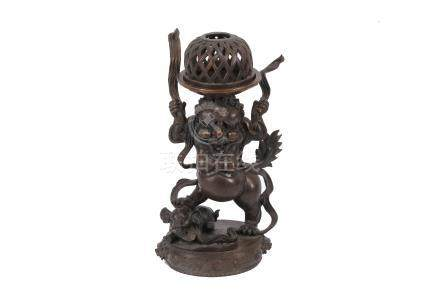 A Chinese bronze incense burner, 20th Century, cast as a demon trampling an elephant, 31cm high;