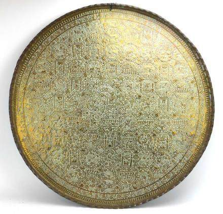 A 19th century Eastern brass tray relief decorated with deities,